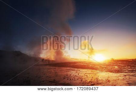 Fantastic sunset Strokkur geyser eruption in Iceland. Fantastic colors.