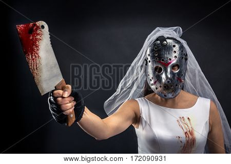 Bride maniac in hockey mask with bloody knife