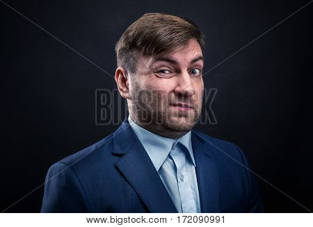 Brutal man in suit on black background