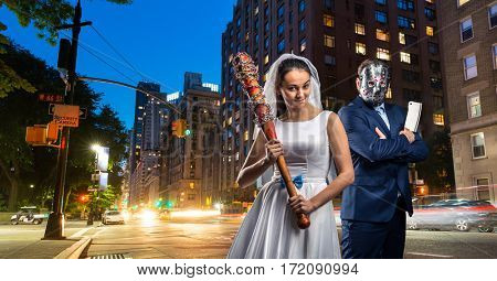 Couple with bat and meat cleaver in night city