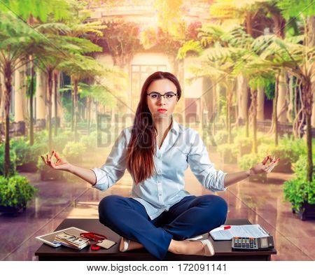 Female bookkeeper yoga meditation on the table