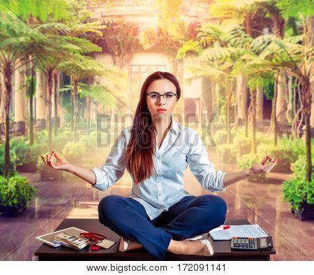 Female bookkeeper yoga meditation on the table