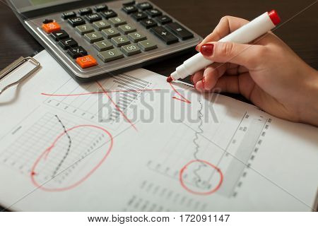 Bookkeeper works with accounting balance sheet
