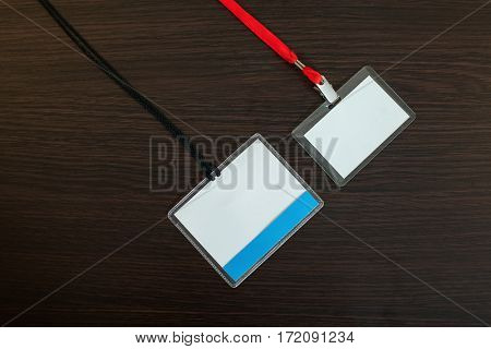 Two empty badges on wooden background
