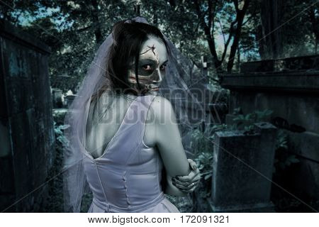 Dead bride, night cemetery on background