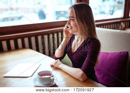 Businesswoman talking by smartphone
