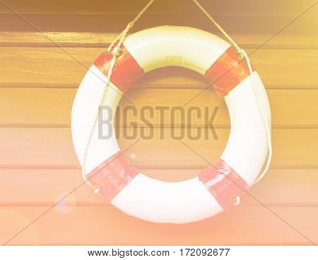 Close up lifebuoy hanging on wood wall