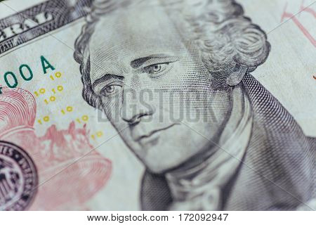 Alexander Hamilton face on US ten or 10 dollars bill macro, united states money closeup