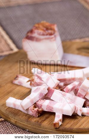 Sliced Chopped Bacon On The Kitchen Wooden Board