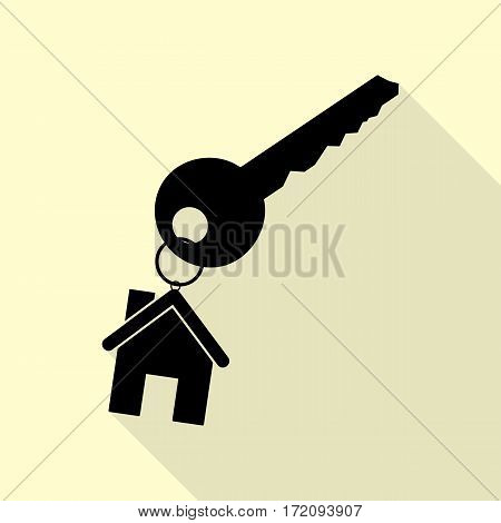 key with keychain as an house sign. Black icon with flat style shadow path on cream background.