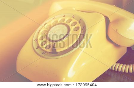 Retro pastel telephone on wooden table with color filters