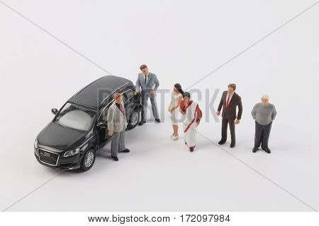 Business Figure At Meeting With Car