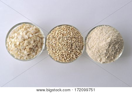 Quinoa in three forms - flour, flakes and grain isolated on white. Alternative gluten-free grain.