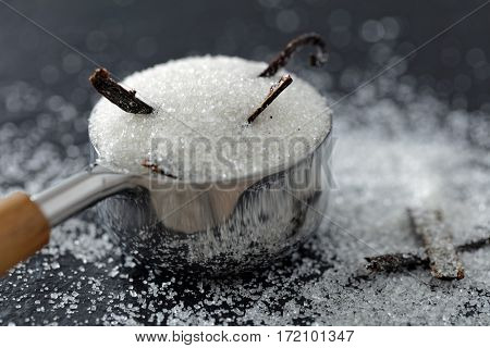 Vanilla beans and sugar in a portioner