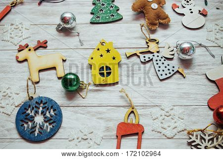 Christmas ornaments and garland lights on wooden white background. Happy New Year. On the eve of the holiday.