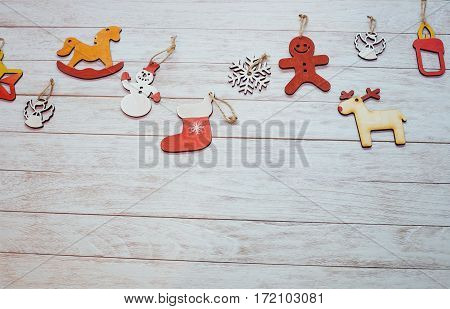 Christmas ornaments and garland lights on wooden white background. Happy New Year. On the eve of the holiday. In anticipation of the holiday.