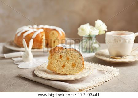 Piece of bundt glazed cake in plate on table