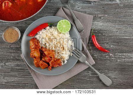 Chicken tikka masala with rice on plate