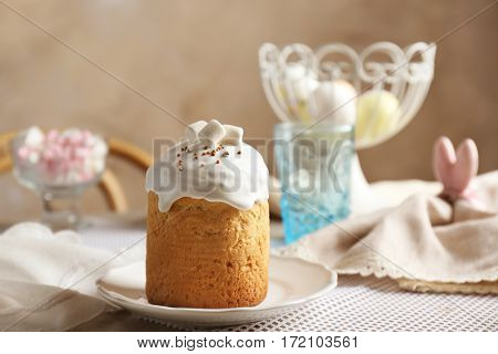 White plate with Easter cake on festive table