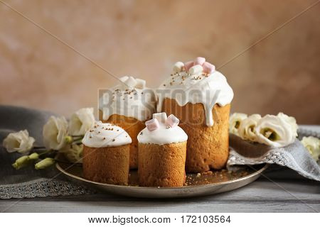 Tray with Easter cakes on wooden table