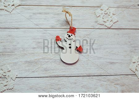 Christmas decorations on wooden white background. Happy New Year. In anticipation of the holiday.
