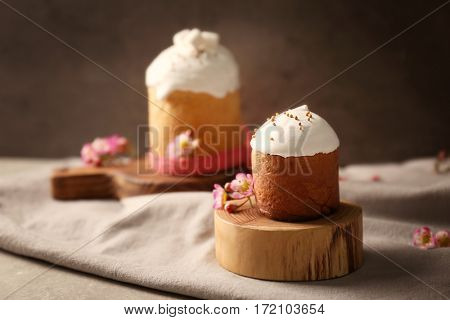 Wooden stand with Easter cake on table