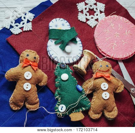 Christmas toy on a wooden table. Cute decorations on the Christmas tree. Creative art and craft idea for kids. top View. In anticipation of the holiday