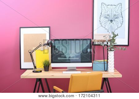 Workplace with computer on table in modern room