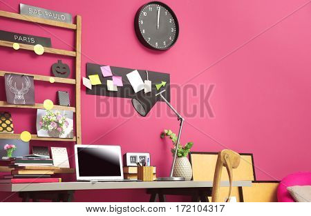 Workplace with laptop on table in modern room