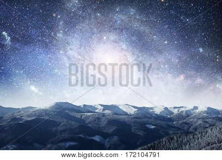 fantastic winter meteor shower and the snow-capped mountains. Dramatic and picturesque scene. Courtesy of NASA. Carpathian, Ukraine, Europe.