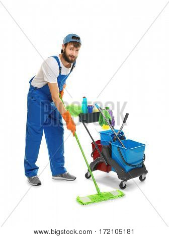Funny young man with cleaning supplies on white background