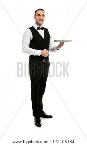 Young handsome waiter holding tray on white background