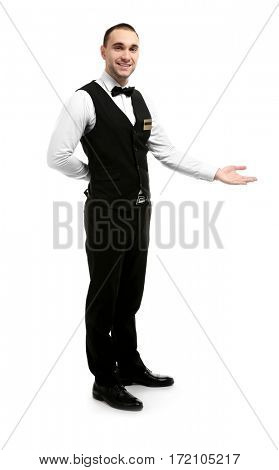 Young handsome waiter standing on white background