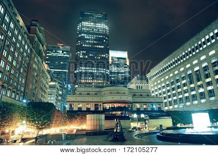 LONDON, UK - SEP 27: Canary Wharf at night on September 27, 2013 in London, UK. It is one of London's two main financial centres with 14M sqr ft of office and retail space.