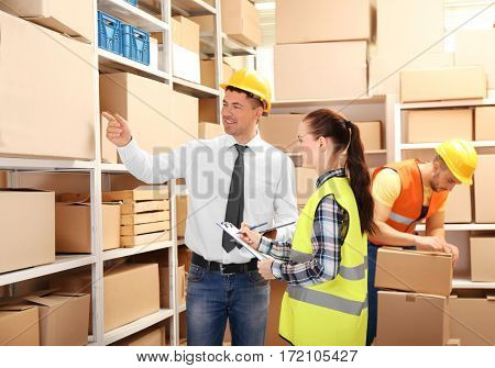 Two business people at warehouse