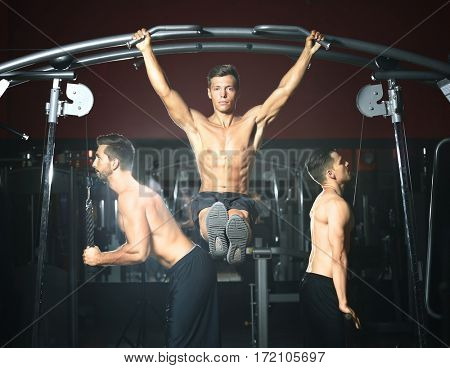 Athletic men training in modern gym