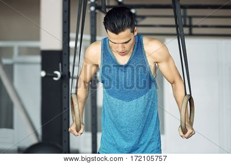 Athletic man training in gym