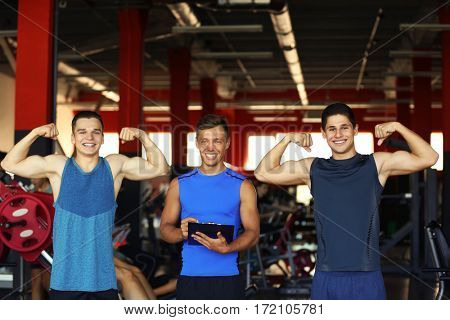 Portrait of athletic men in gym