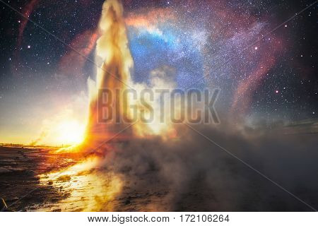 Strokkur geyser eruption in Iceland. Fantastic colors. The magical starry sky. Courtesy of NASA