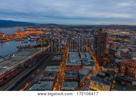 Vancouver Canada - January 28 2017: Vancouver cityscape at night with the harbour Gastown and mountains in the background.