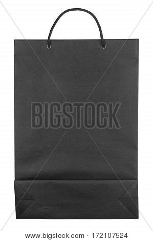 Black paper bag isolated on white background. Flat lay