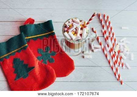 Christmas still life - cup of hot chocolate with marshmallows, candies and toys. New Year. Holiday card. Top view.