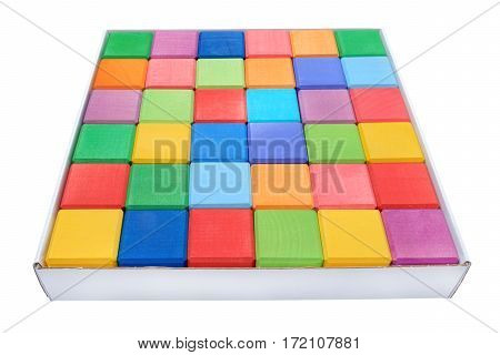 Colorful wooden blocks in cardboard box isolated on white background
