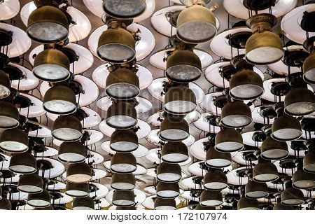 Old storm lanterns hang under the ceiling