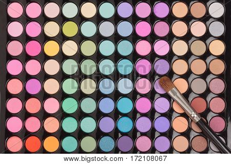 Makeup eye shadow palette with makeup brush. Flat lay