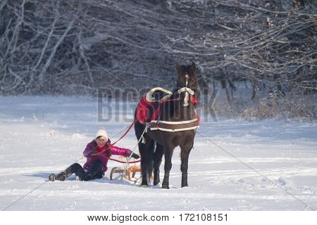 Winter landscape, journey on horse , young girl