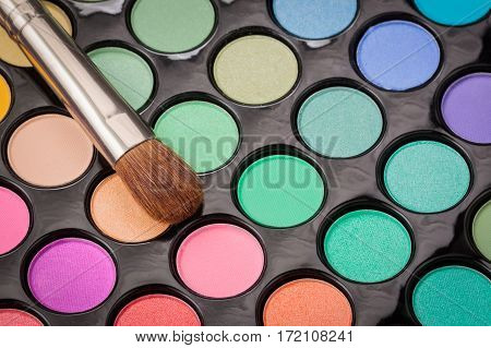 Close-up of make-up eye shadow palette with shadow brush