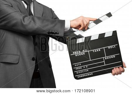 Man wearing costume with black tie holding movie clapper board isolated on white background