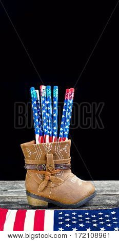 Baby cowboy boots and American flag pencils with room for your type.