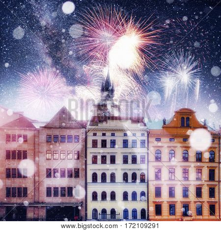 beautiful houses Czech Republic. Photo greeting card. Bokeh light effect, soft filter. Colorful fireworks on the black sky background
